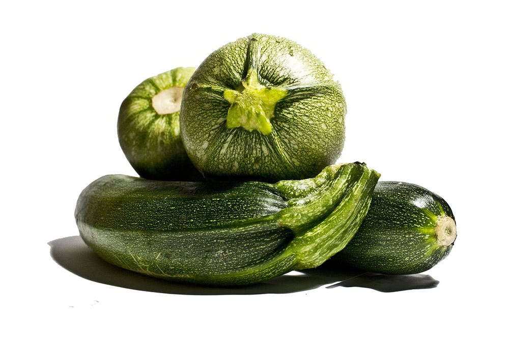 Frozen bio zucchini in slices, in dices and julienne