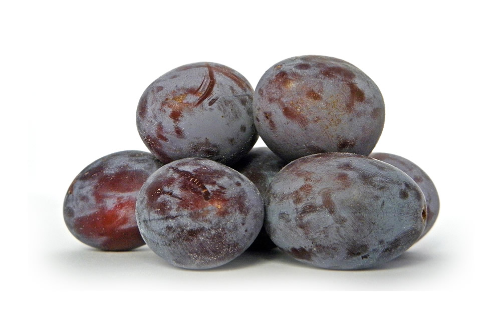 Frozen plum whole and in halves