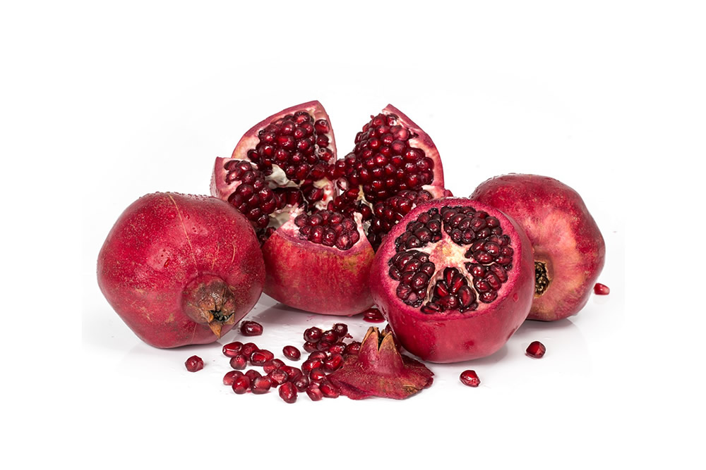 Frozen pomegranate in grains