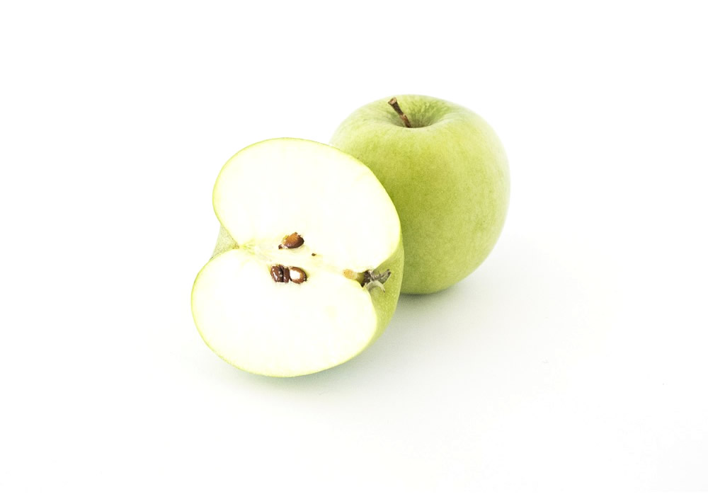 Frozen apple in halves, slices and dices